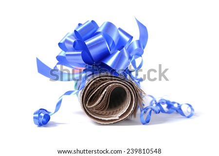 Rolled newspaper with decorative bow isolated on white background - stock photo