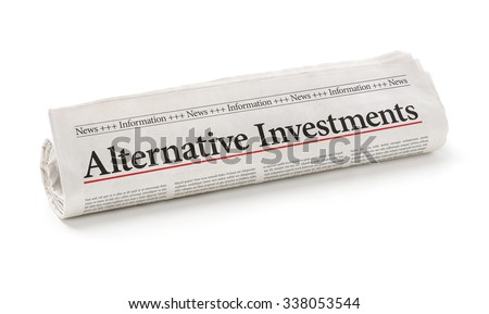 Rolled newspaper with the headline Alternative Investments - stock photo