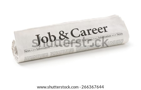 Rolled newspaper with the headline Job and Career - stock photo