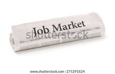 Rolled newspaper with the headline Job Market - stock photo