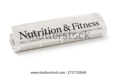 Rolled newspaper with the headline Nutrition and Fitness - stock photo