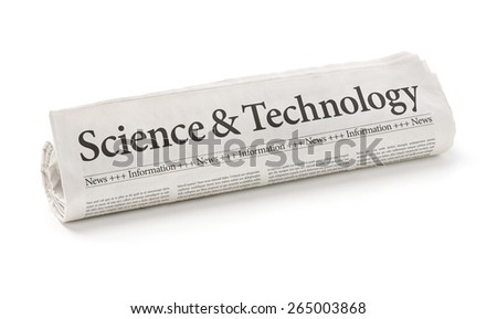 Rolled newspaper with the headline Science and Technology - stock photo