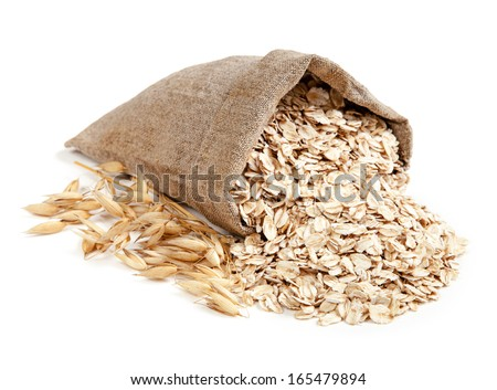 Rolled oats in a bag isolated on white background - stock photo