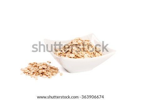 Rolled oats in a bowl isolated on white background - stock photo