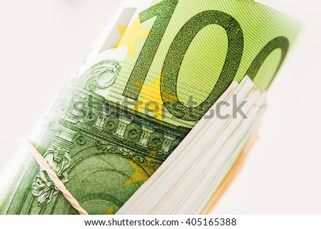 Rolled One Hundred Euros Bills Closeup Photo. European Financial and Banking Concept. - stock photo