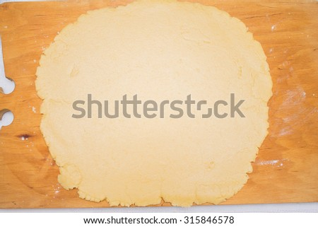 Rolled out dough on cutting board