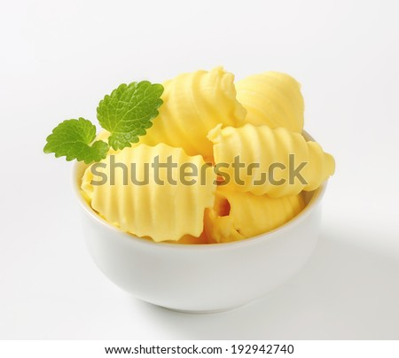 rolled pieces of homemade butter in the bowl