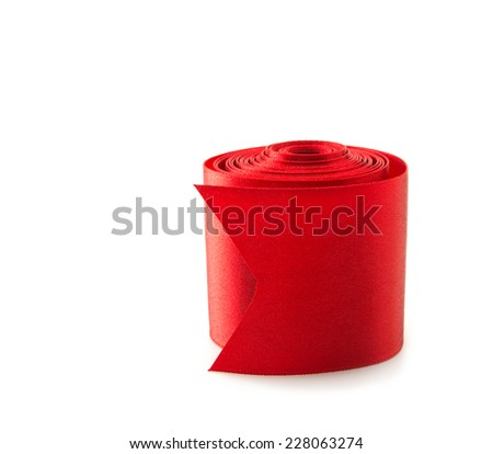 Rolled reel of red ribbon , isolated on white. Preparation for gift wrapping.  - stock photo