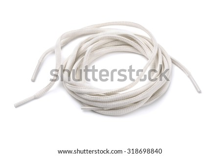 Rolled shoelaces isolated on white - stock photo