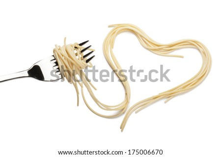 Rolled spaghetti on fork with a pile shaped heart on white background - stock photo