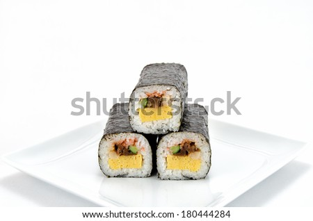 Rolled sushi isolated on a white background. - stock photo