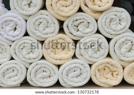 Rolled towel placed over the many. - stock photo