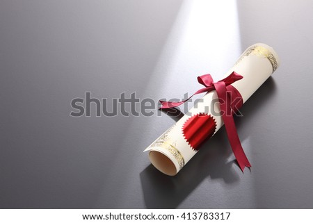 rolled up certificate with ribbon