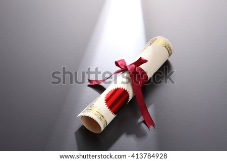 rolled up certificate with ribbon - stock photo