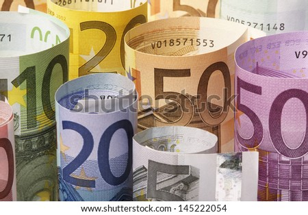 Rolled up Euro banknotes - stock photo