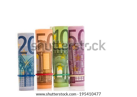 Rolled up Euro bills isoltaed background