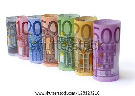 Rolled up Euro bills on white background - stock photo