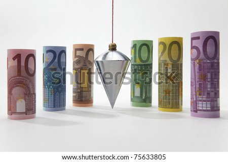 Rolled up Euro bills with plumb bob on white background