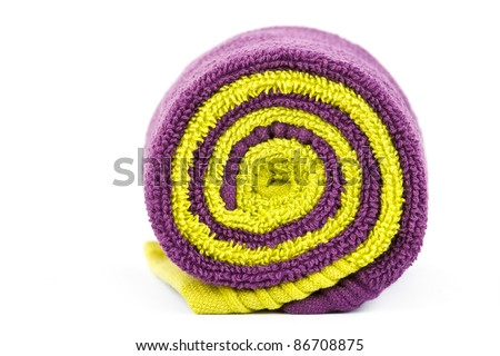 rolled up green and violet towels isolated on white - stock photo