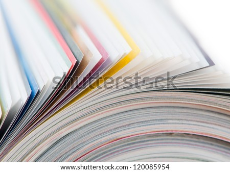 Rolled up magazine. Closeup on pages - stock photo