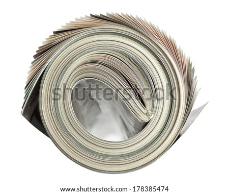 Rolled up magazine isolated on white background with clipping path - stock photo