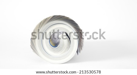 rolled up magazine,newspaper,free copy space - stock photo