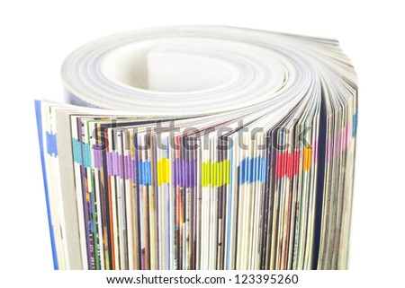 Rolled up magazine, newspaper, with colorful index, white background - stock photo