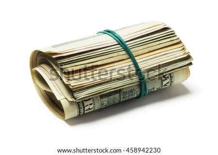 Rolled up of Various Old US Dollar Bills Lying on White Background - stock photo