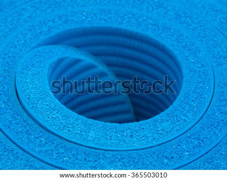 Rolled up thick blue exercise mat closeup - stock photo