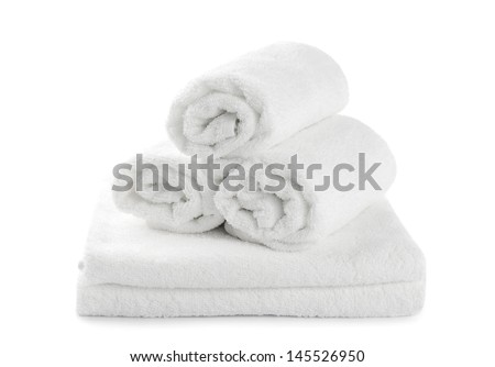 rolled up white beach towel isolated on  white background - stock photo