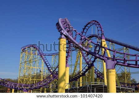 Roller coaster at a theme park - stock photo