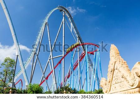 Roller Coaster in Amusement Entartainment Theme Park - stock photo