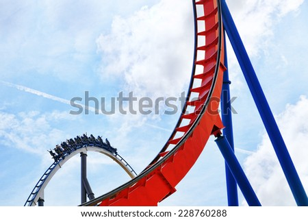 Roller Coaster in funny amusement  park. - stock photo