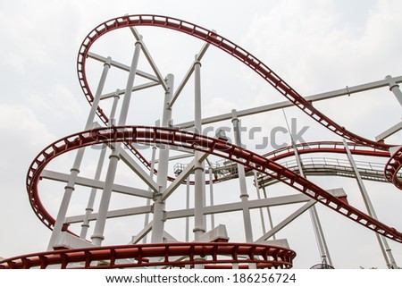 Roller Coaster's loops in Amusement park - stock photo