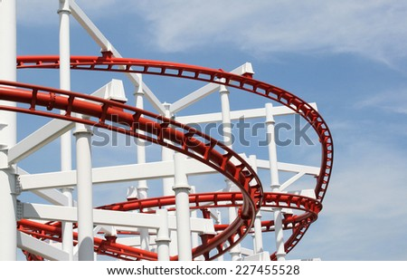Roller coaster with clouds blue sky
