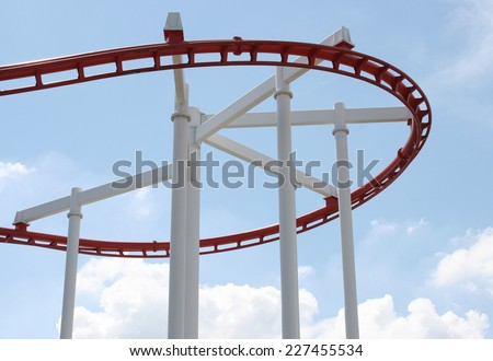 Roller coaster with clouds blue sky - stock photo