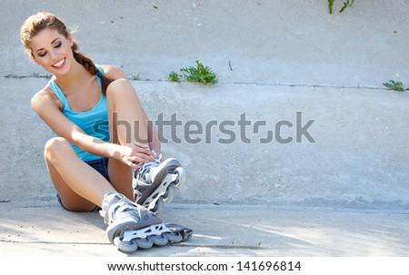 Roller girl resting on the steps - stock photo