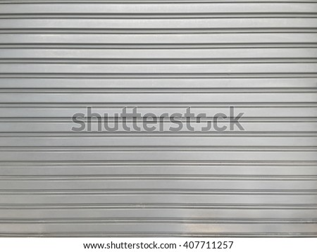 roller shutter doors grey background close up