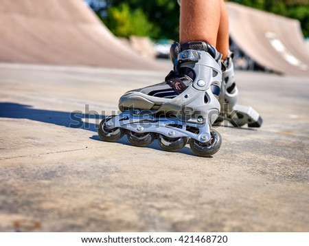 Roller skate legs close up  in skatepark. Low section. Roller skates is extreme sport. - stock photo