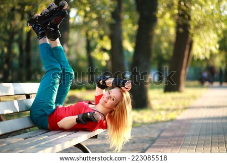 Roller sporty girl in park, woman outdoor fitness activities - stock photo