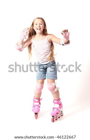 rollerblade child girl Happy childhood. Driving on roller skates. Smiling girl on the rollers isolated on white background. - stock photo