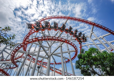 Rollercoaster against blue sky - stock photo