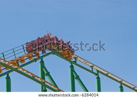 Rollercoaster cart at the top of the track - stock photo