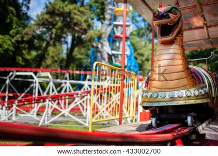 Rollercoaster on rails at Amusement park. Loop rides. - stock photo