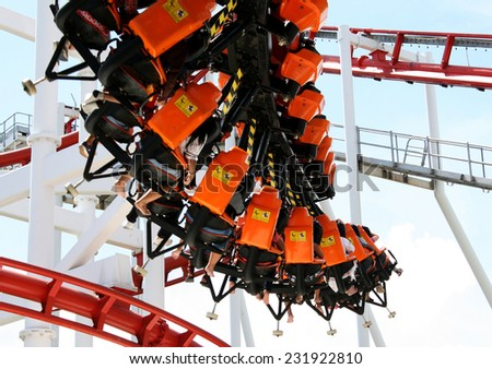 Rollercoaster ride with sky at theme park - stock photo