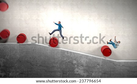 rolling barrell game and running people - stock photo