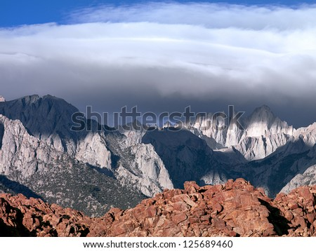 Rolling clouds over the Eastern Sierra Mountains - stock photo