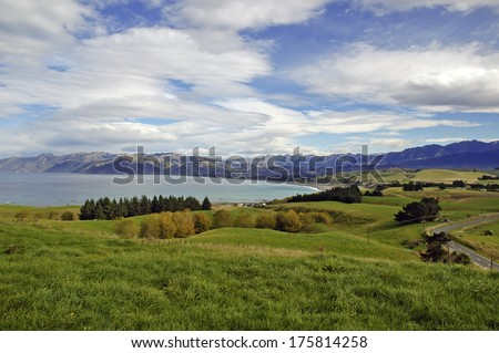 Rolling Hills and Snow Capped Peaks of Kaikoura, New Zealand - stock photo