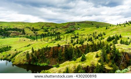 Rolling Hills and the Wide Open Grasslands of the Nicola Valley between Kamloops and Merritt, British Columbia, Canada - stock photo