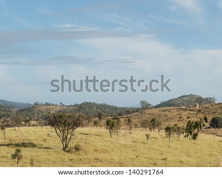 Rolling hills countryside and blue sky Rural Queensland Australia - stock photo